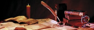 Books, paper, pen and candle