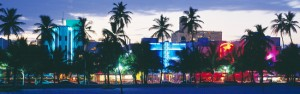 Neon lit hotel signs on Ocean Drive