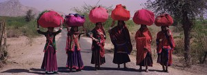 Women luggage on their heads