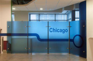 Glass partition continuing the CTA Blue Line theme in the office.
